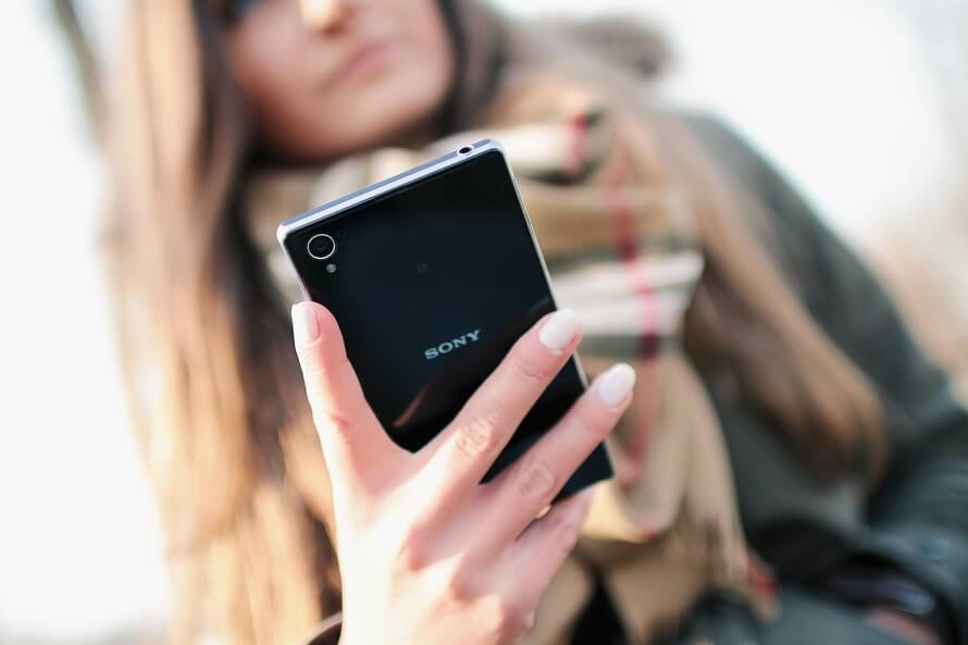 person-woman-hand-smartphone-large